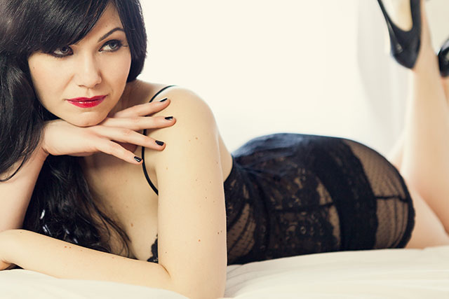 Dress to Impress for Boudoir Photography in the Italian Style at fabyandcarlo.com - Woman lying down