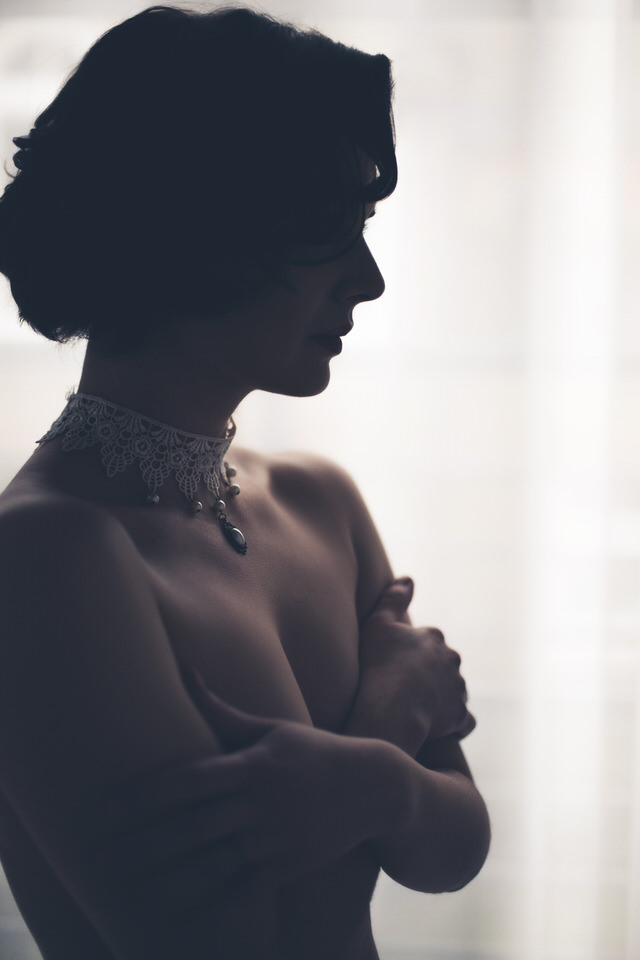 A silhouette of a woman with a bridal neckpiece - wedding decor