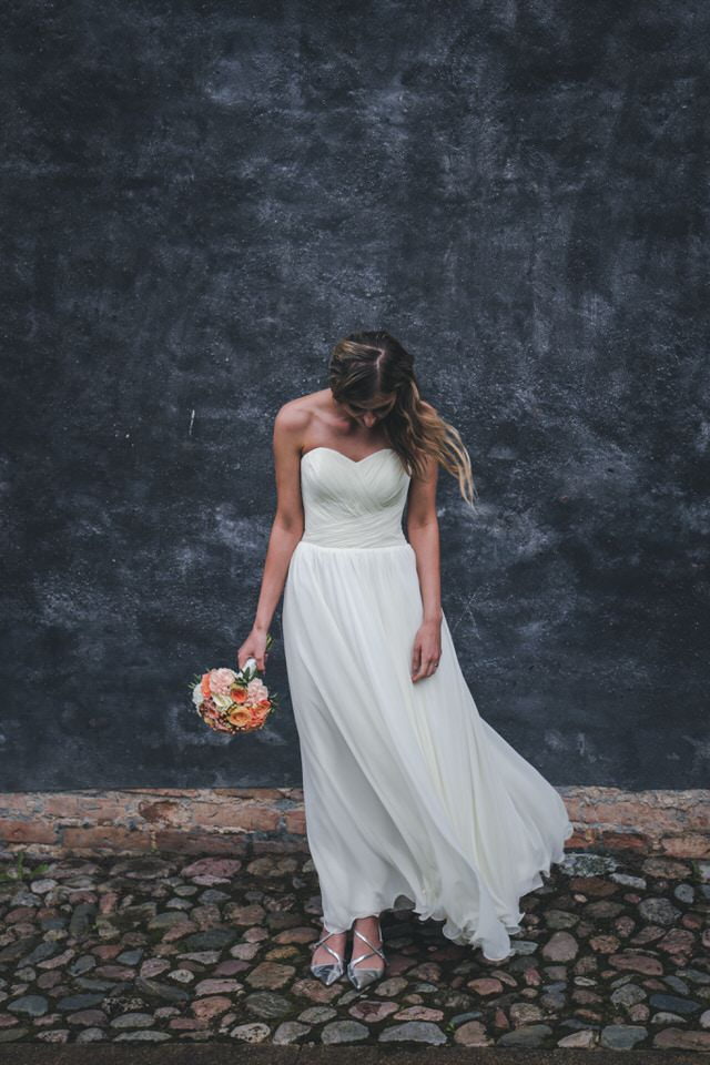 A photo of a new bride in an A-line wedding dress