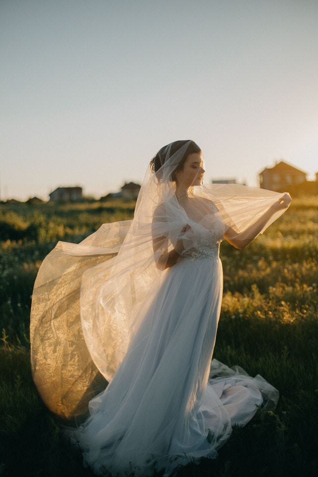 A photo taken at golden hour of a new bride - questions to ask