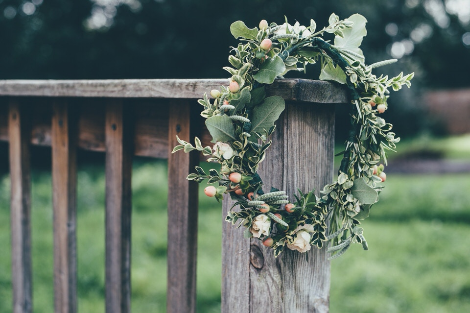 A photo of a flower crown resting on a wooden gate