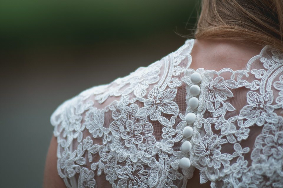 A photo of the lace details on a wedding dress -wedding day