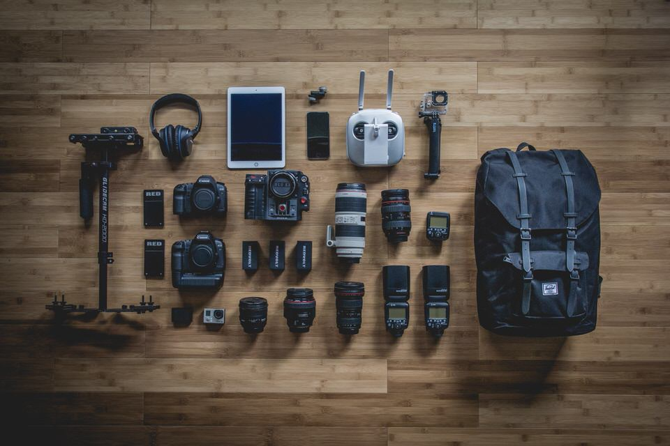 A flat lay photo of camera gear