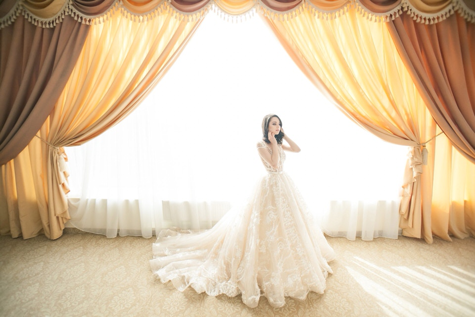 A photo of a new bride in a ballgown dress