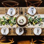 A photo taken from above of a wedding table setting